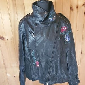 Woman's city chic moto jacket with flower detail